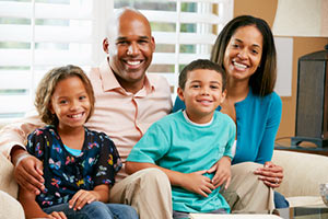 Smiling African American Family Thinking About Health Insurance