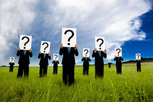 People holding question marks in a field puzzling over Permanent Life Insurance options.